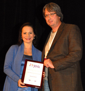 Susan A. Enfield receives the 2012 Administrator of the Year award from Journalism Education Association president Mark Newton.